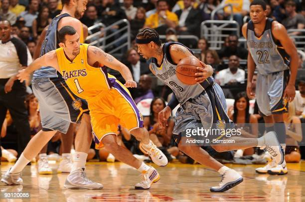 Allen Iverson of the Memphis Grizzlies drives against Jordan Farmar of the Los Angeles Lakers during the game on November 6 2009 at Staples Center in...
