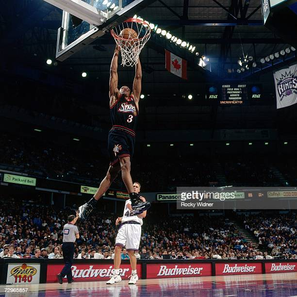 Allen Iverson of the Philadelphia 76ers attempts a dunk against the Sacramento Kings during a 1999 NBA Game played at ARCO Arena in Sacramento...