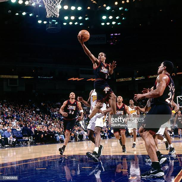 Allen Iverson of the Philadelphia 76ers attempts a layup against the Golden State Warriors during a 1998 NBA Game played at the Arena in Oakland...