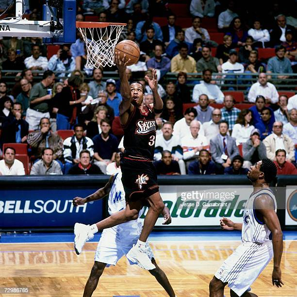 Allen Iverson of the Philadelphia 76ers attempts a layup against the Orlando Magic during a 1999 NBA game at the Orlando Arena in Orlando Florida...