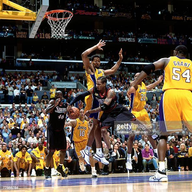 Allen Iverson of the Philadelphia 76ers attempts a pass against Kobe Bryant of the Los Angeles Lakers during a 2001 NBA game at the Staples Center in...