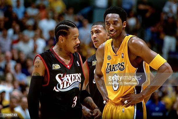 Allen Iverson of the Philadelphia 76ers chats with Kobe Bryant of the Los Angeles Lakers during a 2001 NBA game at the Staples Center in Los Angeles...