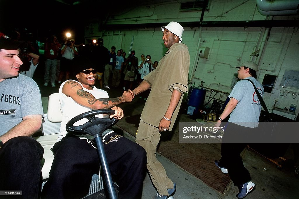 Allen Iverson #3 of the Philadelphia 76ers chats with Kobe Bryant #8 of the Los Angeles Lakers during a 2001 NBA game at the Staples Center in Los Angeles, California.
