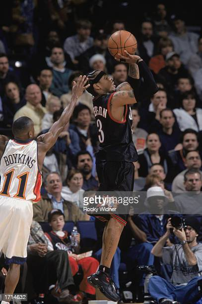 Allen Iverson of the Philadelphia 76ers covered from behind by Earl Boykins of the Golden State Warriors goes up for the jump shot during the game at...