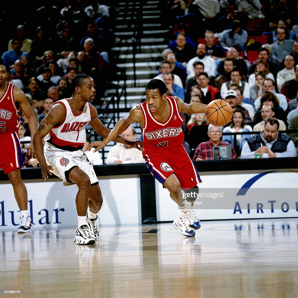 Allen Iverson #3 of the Philadelphia 76ers dribble drives to the basket against the Portland Trail Blazers on March 2, 1997 at the The Rose Garden in Portland, Oregon.