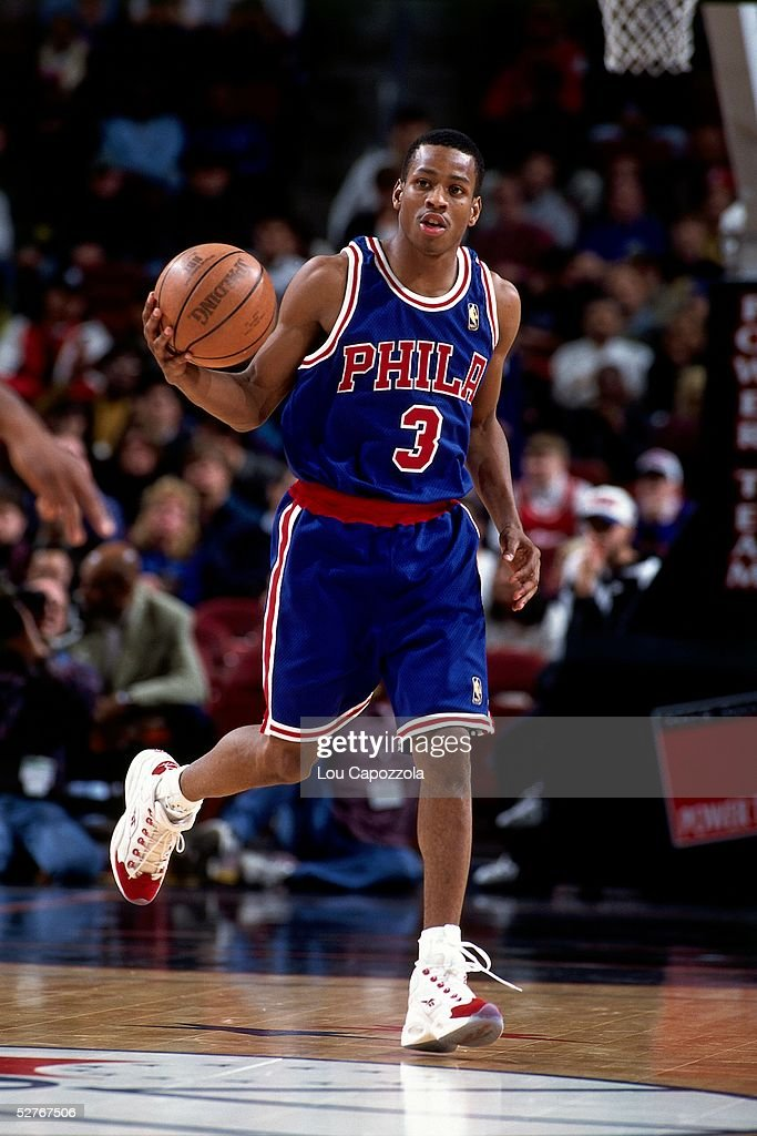 Allen Iverson #3 of the Philadelphia 76ers dribbles the ball upcourt against the New York Knicks during an NBA game at Madison Square Garden on November 23, 1996 in New York, New York. The 76ers won 109-92.