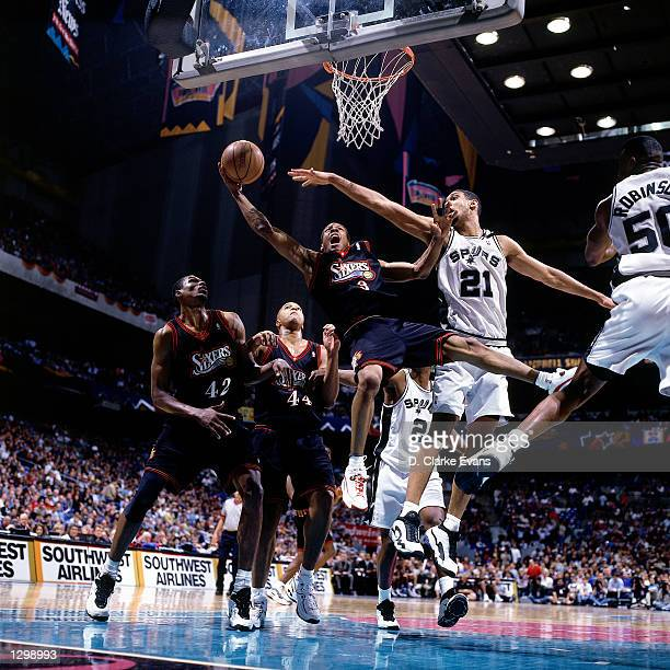 Allen Iverson of the Philadelphia 76ers drives to the basket against Tim Duncan of the San Antonio Spurs during an NBA game at the Alamo Dome in San...