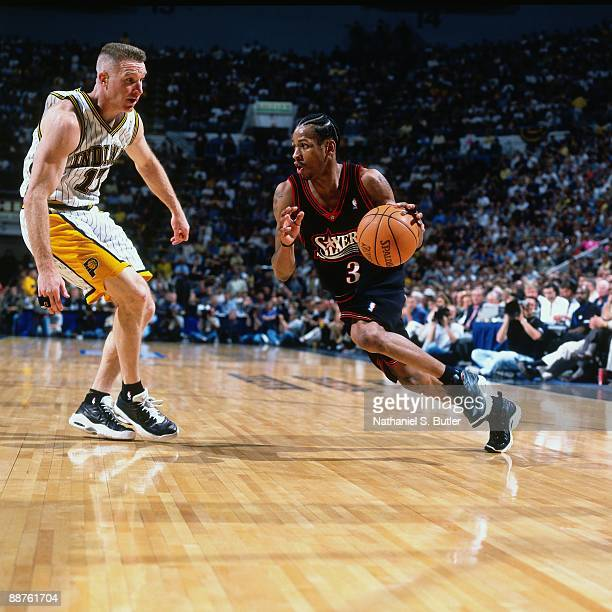 Allen Iverson of the Philadelphia 76ers drives to the basket against Chris Mullin of the Indiana Pacers in Game Two of the Eastern Conference...