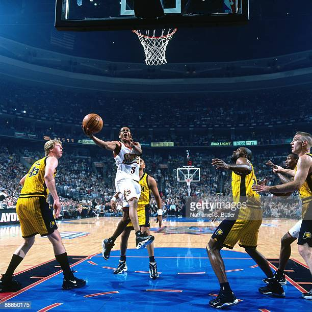 Allen Iverson of the Philadelphia 76ers drives to the basket for a layup against the Indiana Pacers in Game Three of the Eastern Conference...
