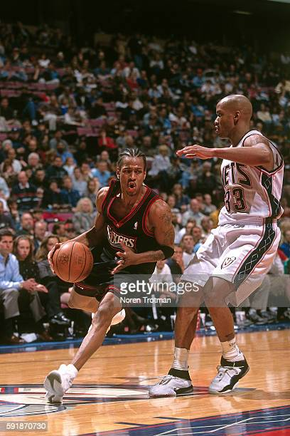 Allen Iverson of the Philadelphia 76ers drives to the basket while guarded by Stephon Marbury of the New Jersey Nets at the Continental Airlines...