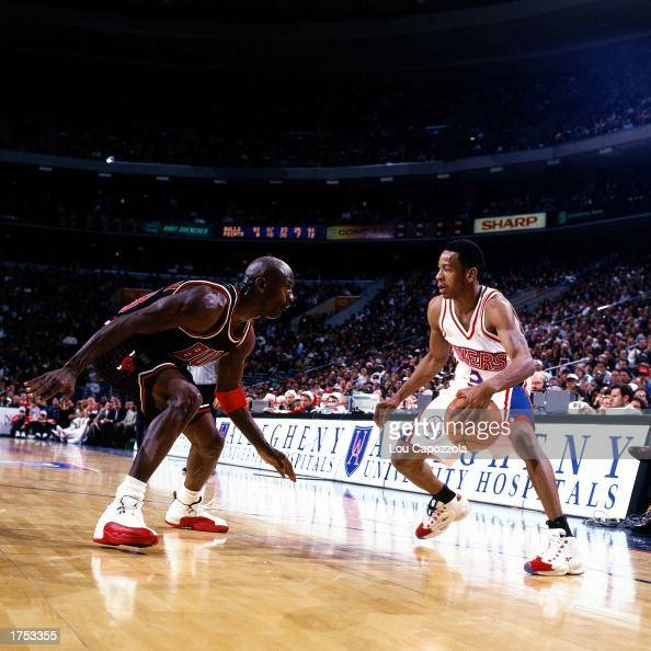 Allen Iverson of the Philadelphia 76ers faces off at the perimeter against Michael Jordan of the Chicago Bulls at the First Union Center during the...