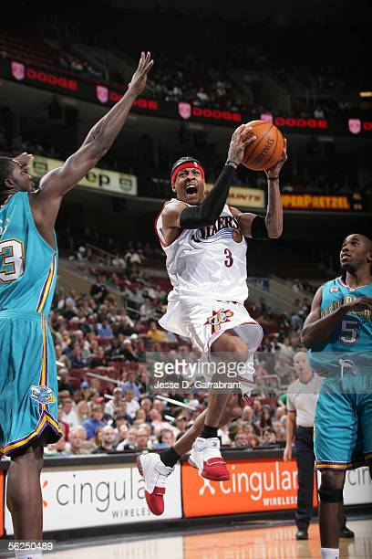 Allen Iverson of the Philadelphia 76ers goes up for a shot against Brandon Bass and Speedy Claxton of the New Orleans/Oklahoma City Hornets November...