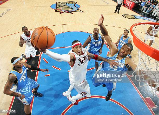 Allen Iverson of the Philadelphia 76ers goes up for a shot against Marcus Camby of the Denver Nuggets on March 9 2006 at the Wachovia Center in...