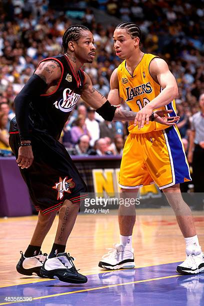 Allen Iverson of the Philadelphia 76ers guards his position against Tyronn Lue of the Los Angeles Lakers on June 6 2001 at STAPLES Center in Los...