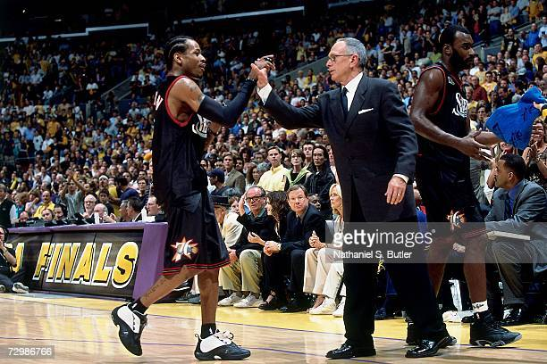 Allen Iverson of the Philadelphia 76ers is high fived by head coach Larry Brown during the 2001 NBA Finals against the Los Angeles Lakers at the...