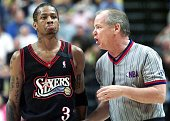Allen Iverson of the Philadelphia 76ers listens to offical Joe Crawford explain a foul against Iverson during the second half of his Eastern...
