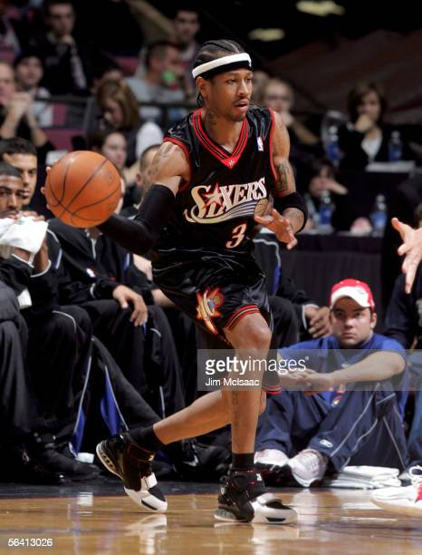 Allen Iverson of the Philadelphia 76ers looks to make a pass against the New Jersey Nets during their game at Continental Airlines Arena on December...