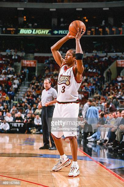 Allen Iverson of the Philadelphia 76ers looks to move the ball during the game against the Charlotte Hornets on April 8 1998 at CoreStates Center in...
