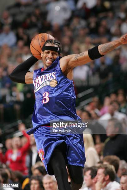 Allen Iverson of the Philadelphia 76ers looks to pass during a game against the Dallas Mavericks at American Airlines Arena on February 27 2006 in...