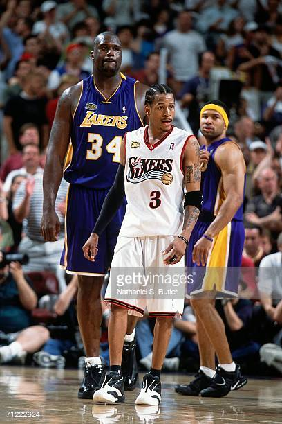 Allen Iverson of the Philadelphia 76ers matches up against Shaquille O'Neal of the Los Angeles Lakers during game five of the NBA FInals June 15 2001...