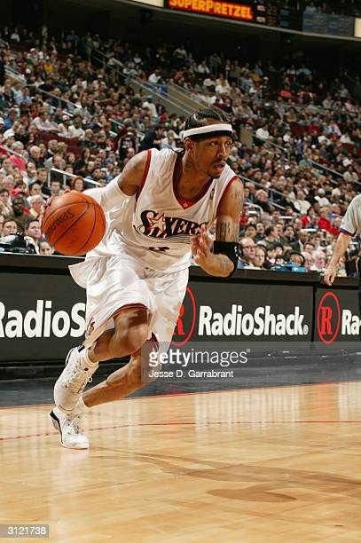 Allen Iverson of the Philadelphia 76ers moves the ball during the game against the Sacramento Kings on March 4 2004 at Wachovia Center in...