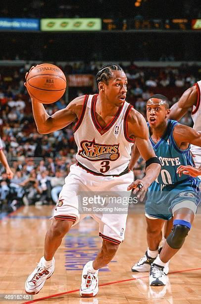 Allen Iverson of the Philadelphia 76ers moves the ball during the game against the Charlotte Hornets on April 8 1998 at CoreStates Center in...