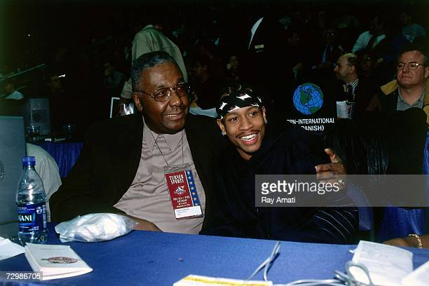 Allen Iverson of the Philadelphia 76ers poses with former Georgetown University coach John Thompson before the 2001 NBA AllStar Game played February...