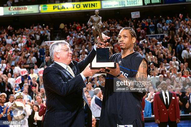 Allen Iverson of the Philadelphia 76ers receives the league MVP trophy from NBA Commissioner David Stern prior to the game against the Toronto...