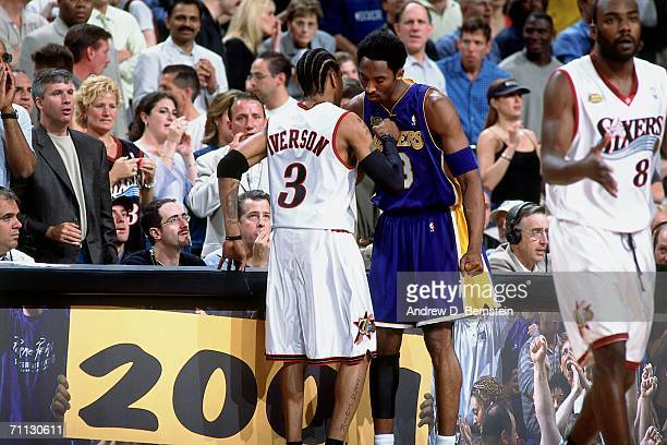 Allen Iverson of the Philadelphia 76ers shakes hands with Kobe Bryant during game five of the 2001 NBA Finals played June 15 2001 at the First Union...