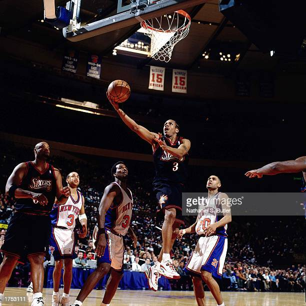 Allen Iverson of the Philadelphia 76ers shoots a driving layup against the New York Knicks at the Madison Square Garden during the 1998 season in New...
