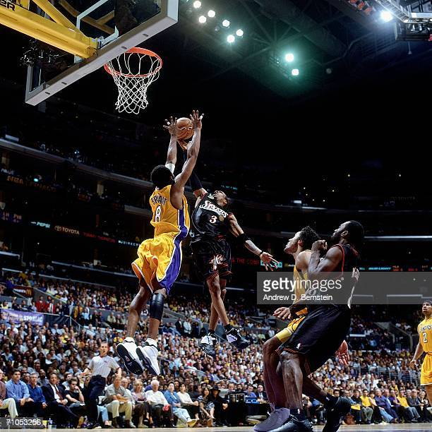Allen Iverson of the Philadelphia 76ers shoots a layup against Kobe Bryant of the Los Angeles Lakers in game one of the 2001 NBA Finals on June 6...