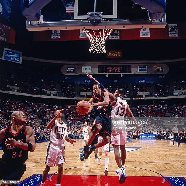 Allen Iverson of the Philadelphia 76ers shoots against Kendall Gill of the New Jersey Nets circa 1998 at the Contintental Airlines Arena in East...