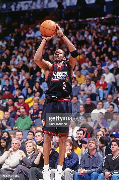 Allen Iverson of the Philadelphia 76ers shoots against the Toronto Raptors on November 14 1999 at the Air Canada Centre in Toronto Ontario in Canada...