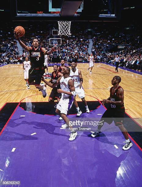 Allen Iverson of the Philadelphia 76ers shoots against the Toronto Raptors on November 14 1999 at the Air Canada Centre in Toronto Ontario Canada...