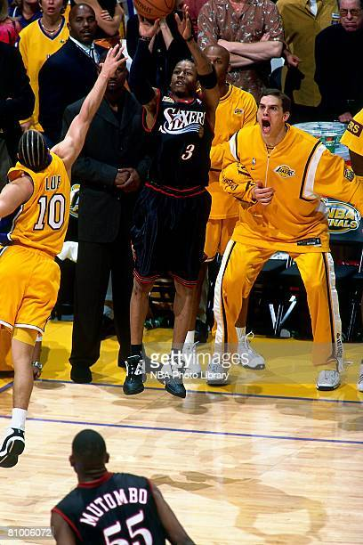 Allen Iverson of the Philadelphia 76ers shoots the game winning shot over Tyronn Lue of the Los Angeles Lakers during Game One of the 2001 NBA Finals...