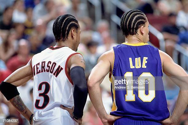 Allen Iverson of the Philadelphia 76ers stands side by side Tyronn Lue of the Los Angeles Lakers during game three of the 2001 NBA Finals played June...