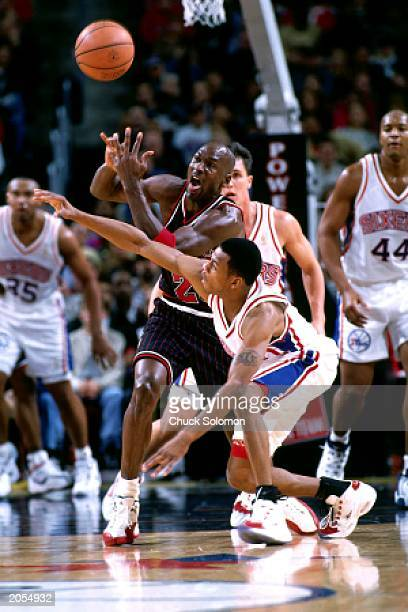 Allen Iverson of the Philadelphia 76ers steals the ball from Michael Jordan of the Chicago Bulls during the NBA game at the Spectrum on December 21...