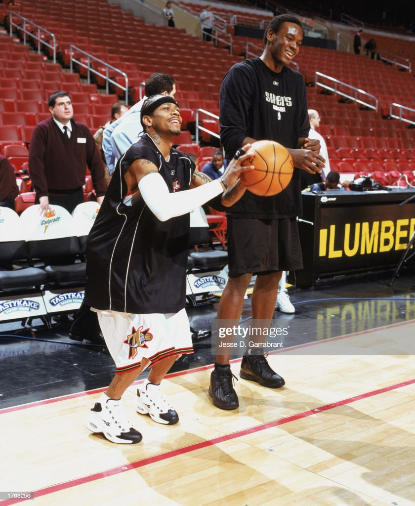Allen Iverson of the Philadelphia 76ers takes a practice shot with John Salmons before the NBA game against the Atlanta Hawks at First Union Center...
