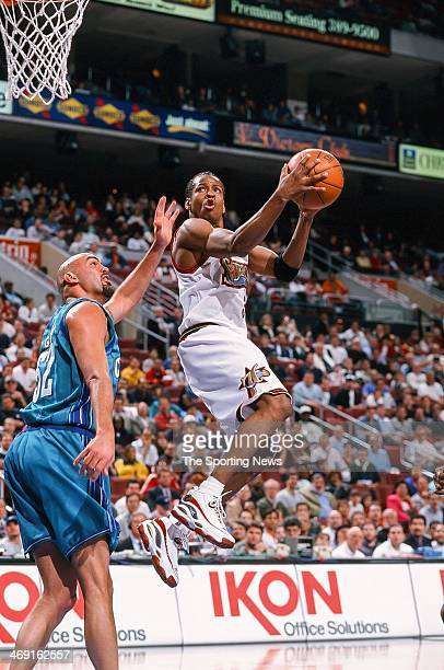 Allen Iverson of the Philadelphia 76ers takes the ball to the basket during the game against the Charlotte Hornets on April 8 1998 at CoreStates...