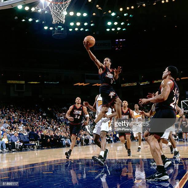 1998 Allen Iverson of the Philadelphia Sixers drives to the basket against the Golden State Warriors during a NBA game at The Arena @ Oakland in 1998...