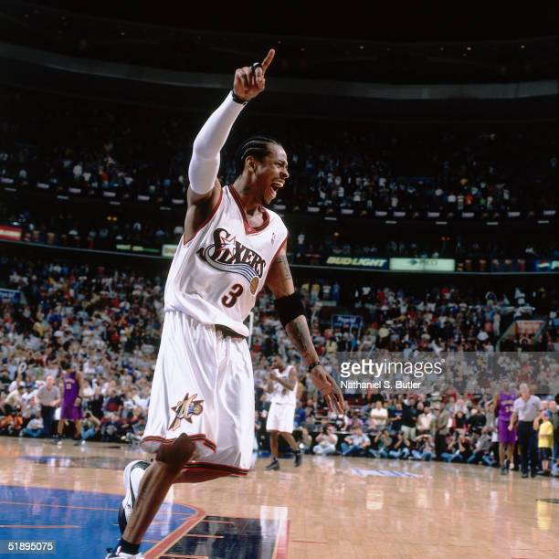 Allen Iverson of the Philadelphia Sixers shows emotion after making a shot against the Toronto Raptors during a NBA game at the First Union Arena in...