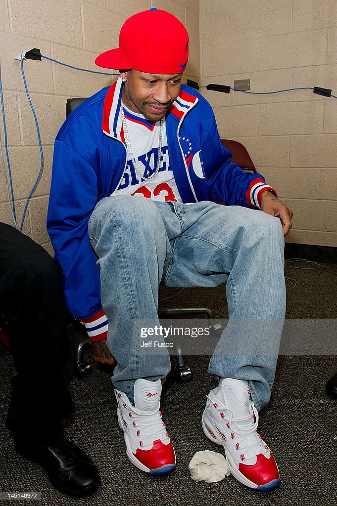 Allen Iverson puts on a Reebok Question sneaker at the Wells Fargo Center on May 23, 2012 in Philadelphia, Pennsylvania. Iverson's original Reebok Question re-launches Friday, May 25th for the first time since 1996.