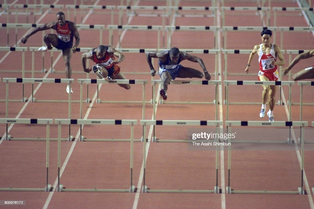 Allen Johnson (2nd R) of the United States and Colin Jackson (2nd L) of Great Britain compete in the Men's 110m Hurdles during the TOTO Super Athletic Championships at the National Stadium on September 15, 1995 in Tokyo, Japan.