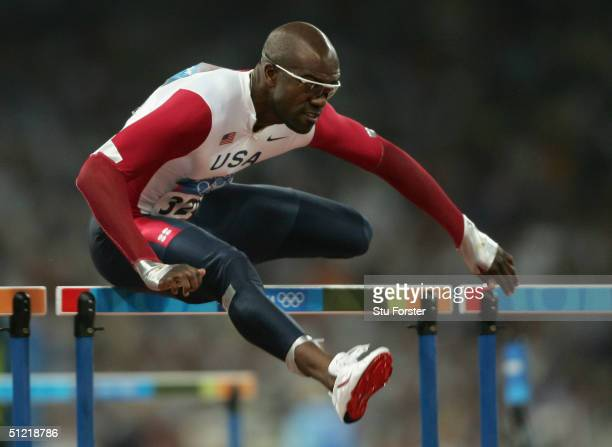 Allen Johnson of USA competes in the men's 110 metre hurdle event on August 25 2004 during the Athens 2004 Summer Olympic Games at the Olympic...