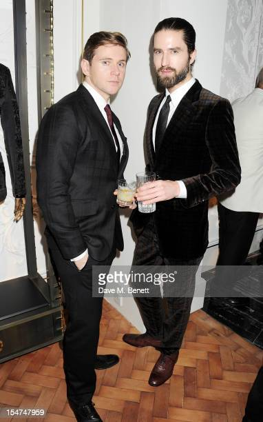 Allen Leech and Jack Guinness attend the launch of the Alexander McQueen Menswear boutique on Savile Row on October 25 2012 in London England
