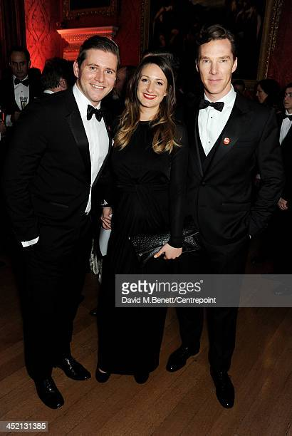 Allen Leech Doone Forsyth and Benedict Cumberbatch attend the Winter Whites Gala in aid of Centrepoint at Kensington Palace on November 26 2013 in...