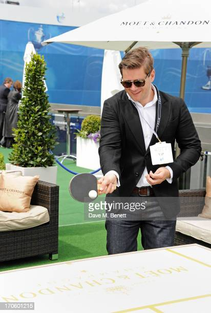Allen Leech plays table tennis at The Moet Chandon Suite at The Aegon Championships Queens Club SemiFinals on June 15 2013 in London England