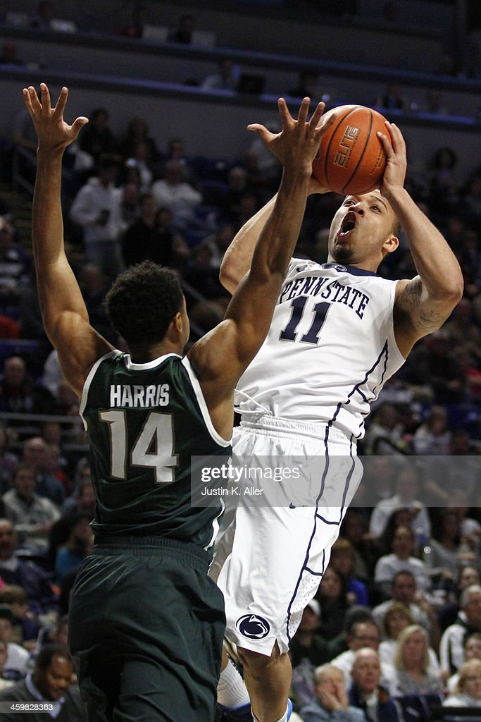 Allen Roberts #11 of the Penn State Nittany Lions is fouled by Gary Harris #14 of the Michigan State Spartans at the Bryce Jordan Center on December 31, 2013 in State College, Pennsylvania.