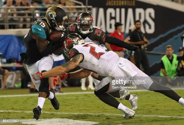Allen Robinson of the Jacksonville Jaguars attempts a reception against Chris Conte of the Tampa Bay Buccaneers during a preseason game at EverBank...
