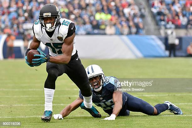 Allen Robinson of the Jacksonville Jaguars makes a catch past Blidi WrehWilson of the Tennessee Titans during the game at Nissan Stadium on December...